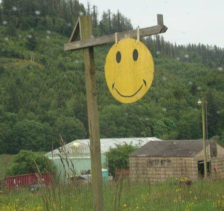 Smile face sign through rainy window